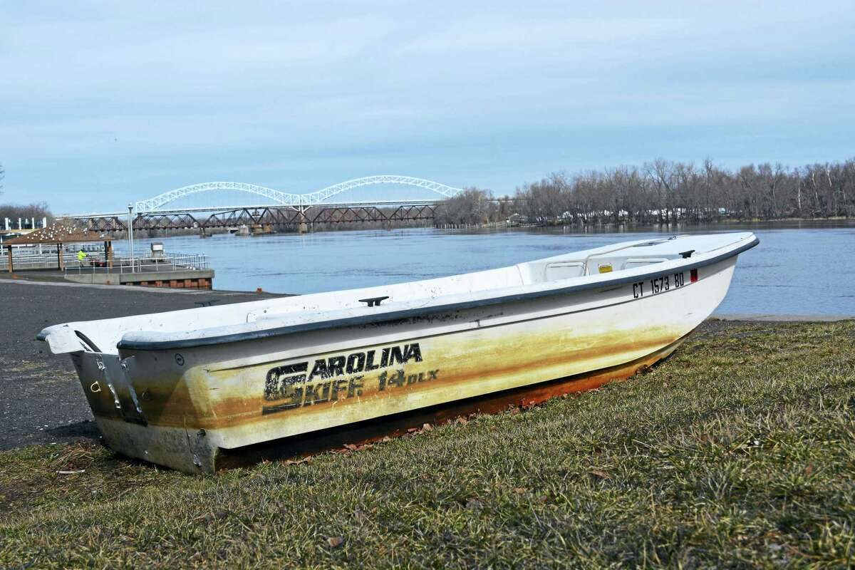 A skiff poised at the Harbor Park boat launch creates a picturesque scene along the Connecticut River in Middletown, where the city hopes to replace two aging crew boathouses with a single large one, and possibly with a banquet hall on the top level.