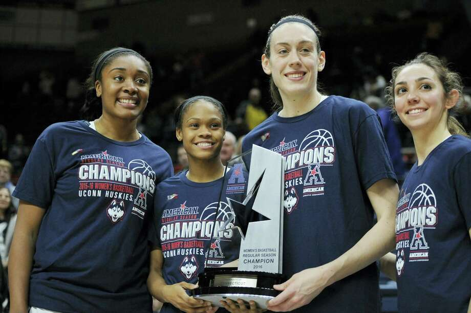 UConn seniors Morgan Tuck, Moriah Jefferson, Breanna Stewart and Briana Pulido, from left, pose with the regular season conference championship trophy at the end of the team's win against SMU Wednesday. Photo: Jessica Hill — The Associated Press  / FR125654 AP