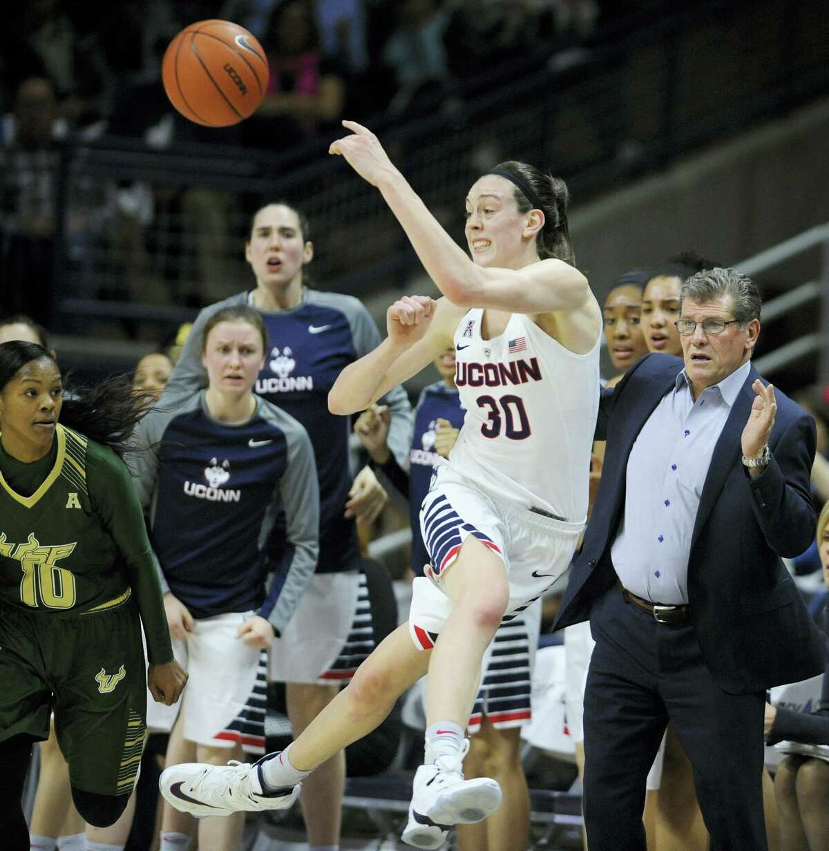 Connecticut's Breanna Stewart keeps the photo inbounds as head coach Geno Auriemma, right, and South Florida's Courtney Williams, left, look on, in the first half of an NCAA college basketball game Monday, Feb. 29, 2016, in Storrs, Conn. (AP Photo/Jessica Hill)