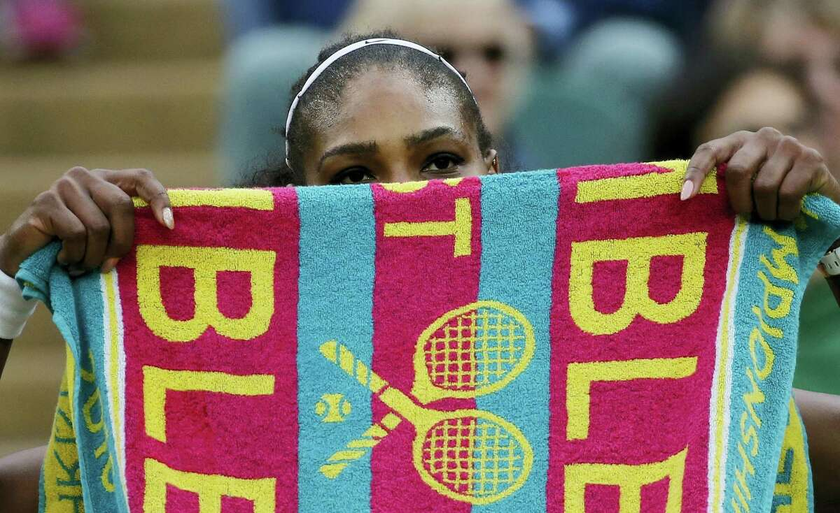 Serena Williams holds up a towel during a break in her match against Christina McHale no Friday.