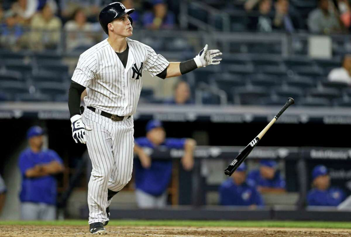 New York Yankees' Tyler Austin drop his bat and watches his two-run home run in the seventh inning against the Toronto Blue Jays on Tuesday. The Yankees hung on to beat the Jays 7-6.