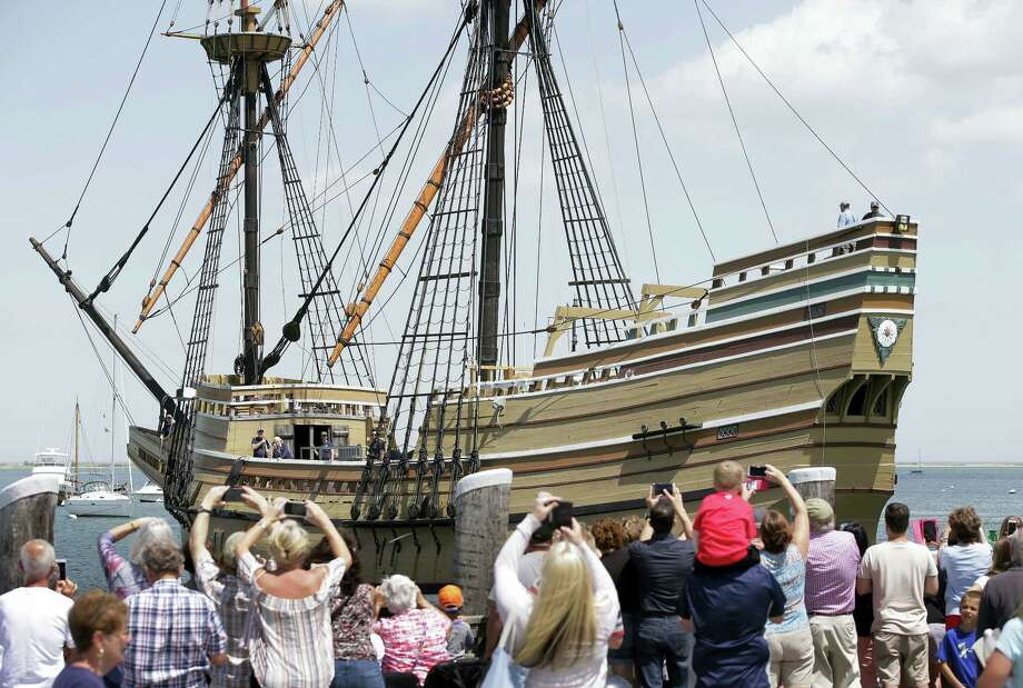 In this June 6, 2016, file photo, people on a wharf watch as the Mayflower II arrives in Plymouth Harbor in Plymouth, Mass. The 60-year-old replica of the ship that carried the Pilgrims to Massachusetts in 1620 was being towed Tuesday, Nov. 1, 2016, to Mystic, Conn., for major reconstruction that's expected to take 2½ years. Photo: AP Photo/Steven Senne, File   / Copyright 2016 The Associated Press. All rights reserved.