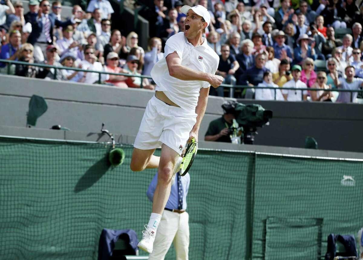 Sam Querrey celebrates after beating Novak Djokovic.