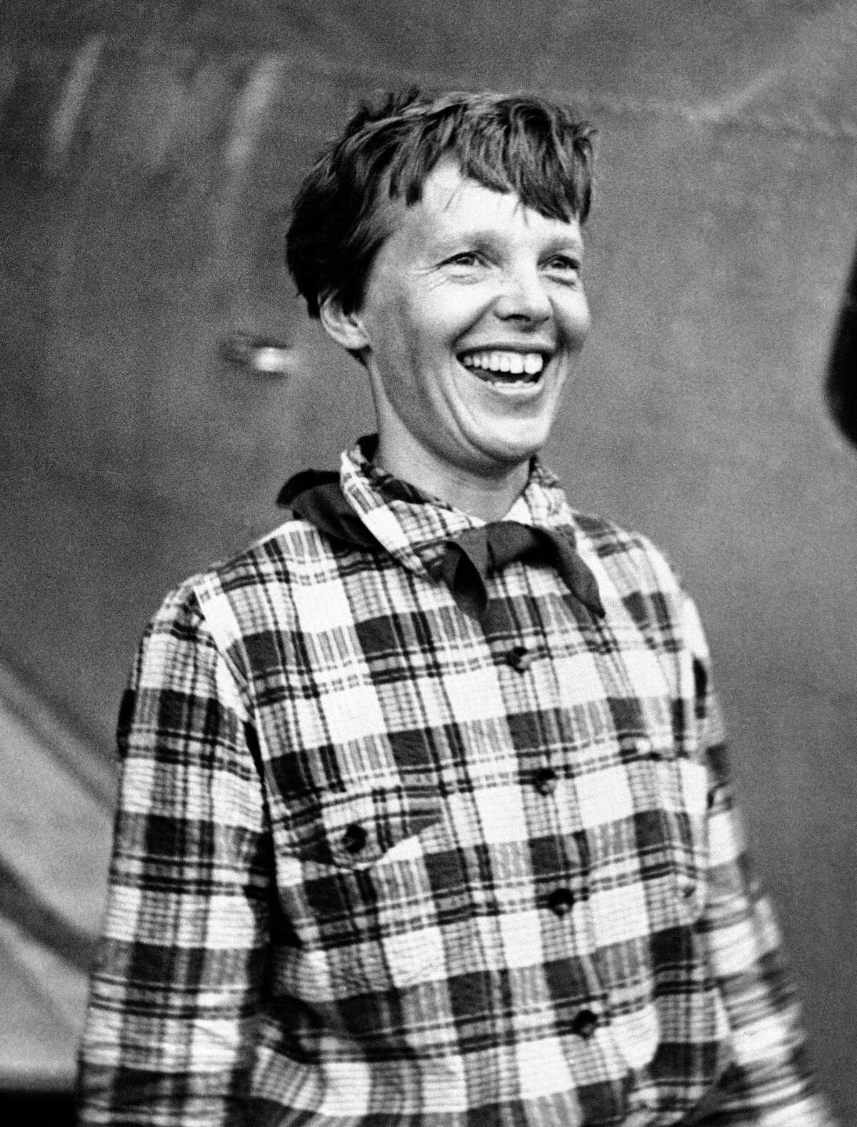In this June 6, 1937, file photo, Amelia Earhart, the American airwoman who was flying round the world, arrived at Port Natal, Brazil, and took off on her 2,240-mile flight across the South Atlantic to Dakar, Africa. A group investigating the mystery of what happened to Amelia Earhart announced on Oct. 22, 2016, that it has uncovered another connection between the pioneering female pilot and a body found 76 years ago on a remote Pacific island.