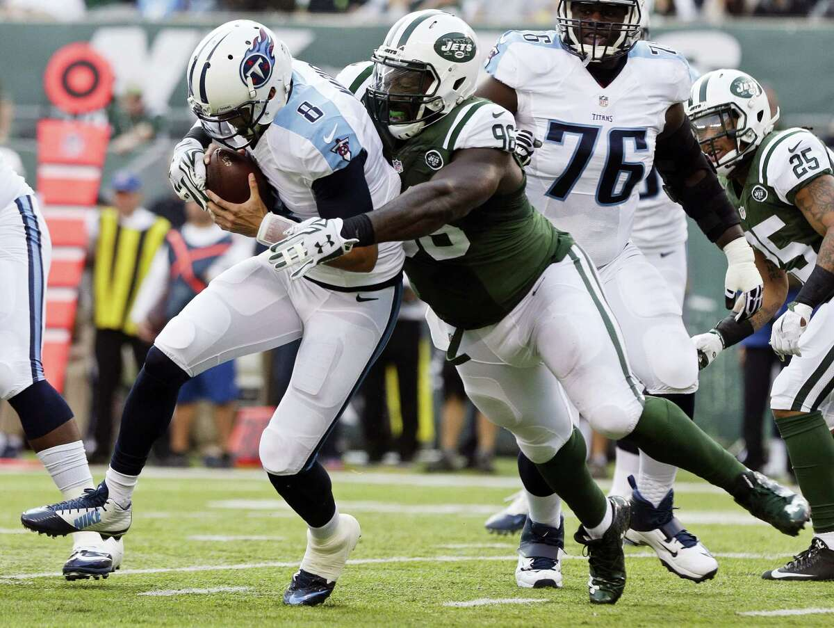 New York Jets defensive end Muhammad Wilkerson (96) sacks Tennessee Titans quarterback Marcus Mariota during a game this past season.