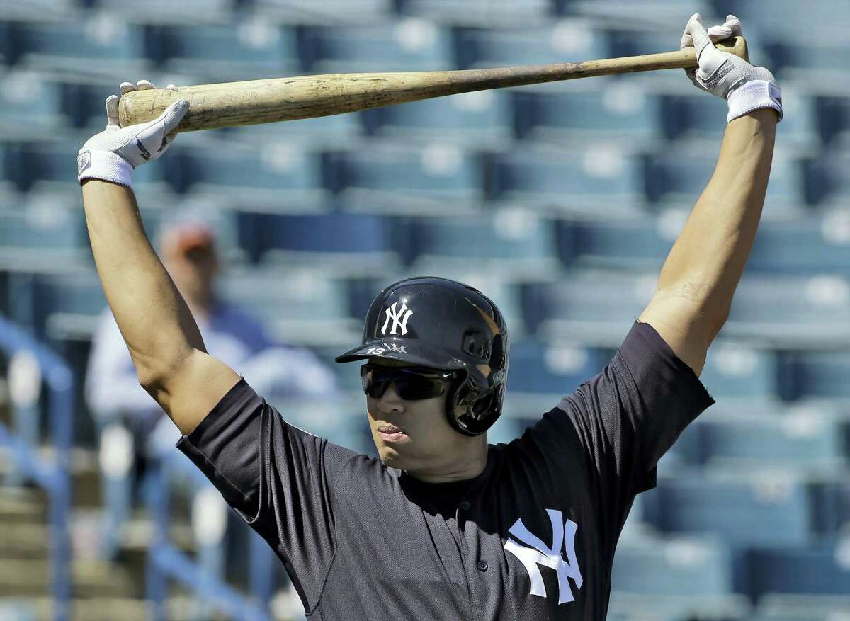 Alex Rodriguez stretches before taking batting practice during a recent spring training workout.