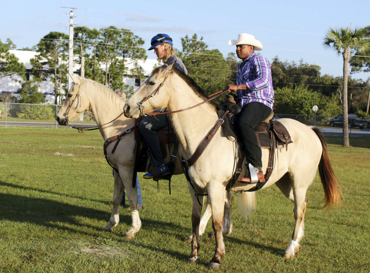 Yoenis Cespedes, right, and Noah Syndergaard ride horses at the team's spring training facility on Tuesday.