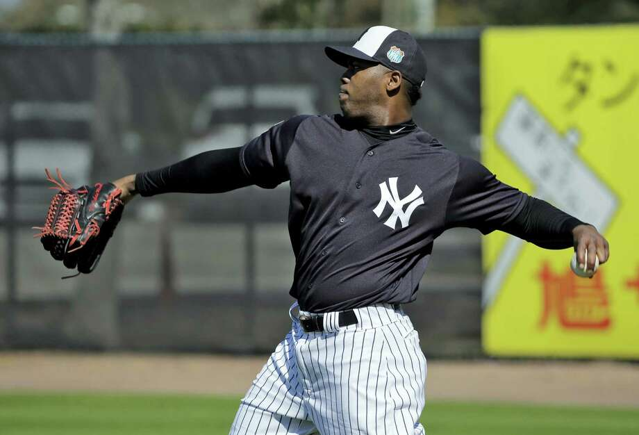 New York Yankees pitcher Aroldis Chapman agreed to accept a 30-game suspension under Major League Baseball's domestic violence policy. Photo: The Associated Press File Photo  / AP