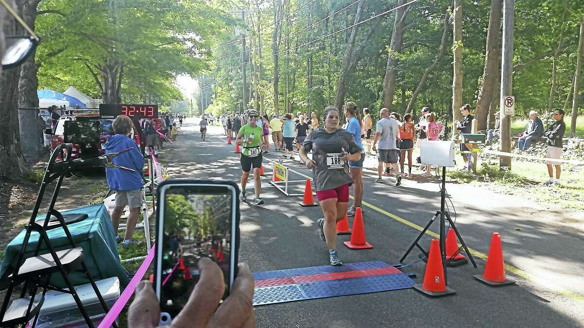 Cassandra Day - The Middletown Press Runners participate in the annual Haddam Neck Fair weekend 5K race.