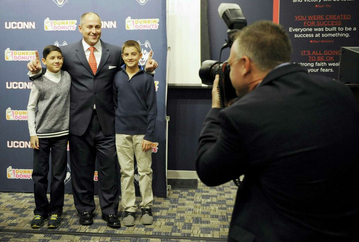 David Benedict, center, poses for a photograph with his sons Jake, left, and Sam, right, before Tuesday's press conference.