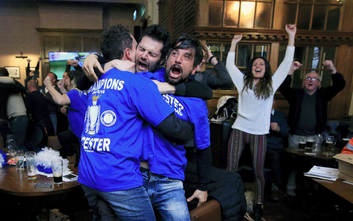 Leicester City fans react in Hogarths public house in Leicester, central England, after Chelsea's Eden Hazard scores the equalising goal against Tottenham Hotspur in their English Premier League soccer match. The match ended 2-2 resulting in Leicester City winning the Premier League, Monday.