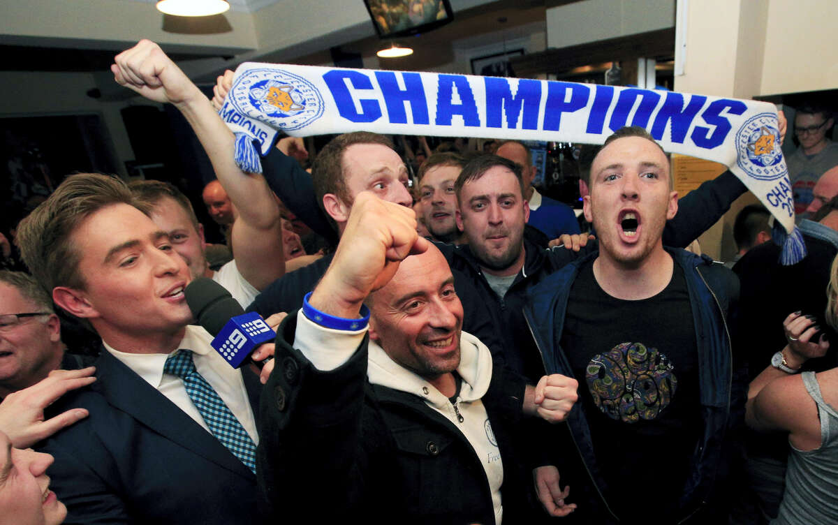 Leicester City fans celebrate their team's improbable English Premier League soccer championship Monday. The team was a 5,000-1 underdog to win the title at the beginning of the season, never having won the crown in 132 years of playing.