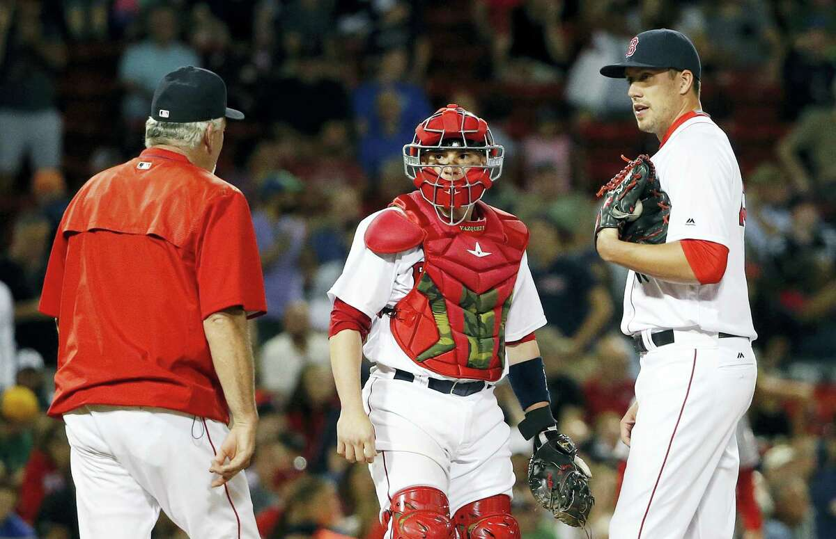 Red Sox pitching coach Carl Willis, left, visits the mound with Christian Vazquez, center, and Pat Light during the seventh inning on Saturday.