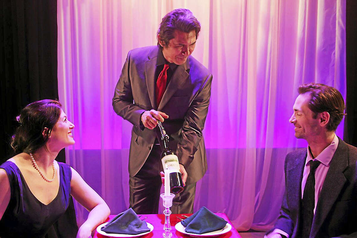 """Photo by Paul RothEvan (Tara Franklin) and Andrew (Ryan Wesley Gilreath) are served by Lucifer himself (Lou Diamond Phillips) in a scene from """"Burning Desire"""" at Seven Angels Theater in Waterbury."""