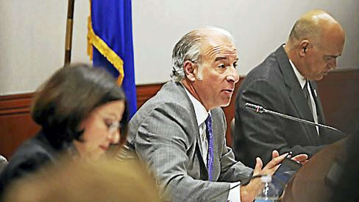 State Rep. Antonio Guerrera, D-Rocky Hill, at microphone