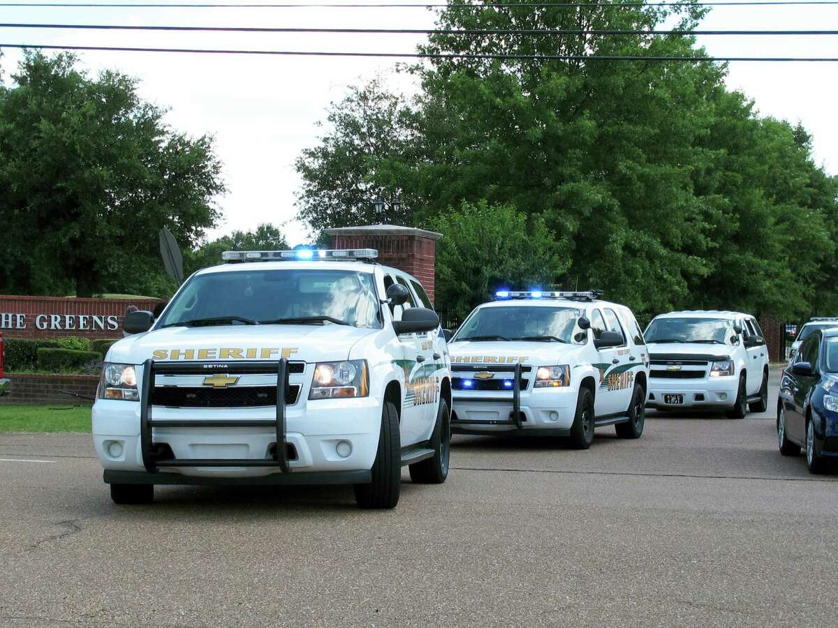 Shelby County Sheriff's Office vehicles leave a gated neighborhood where four children were found stabbed to death Friday, July 1, 2016, in suburban Memphis, Tenn.