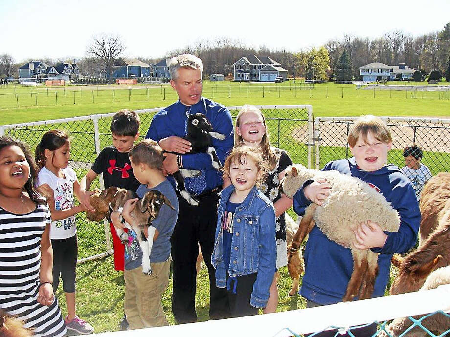 Cromwell Woodside Intermediate School children have just completed a unique program to develop self-confidence while also fostering an appreciation for animals. Photo: Marcia Sacco Photo