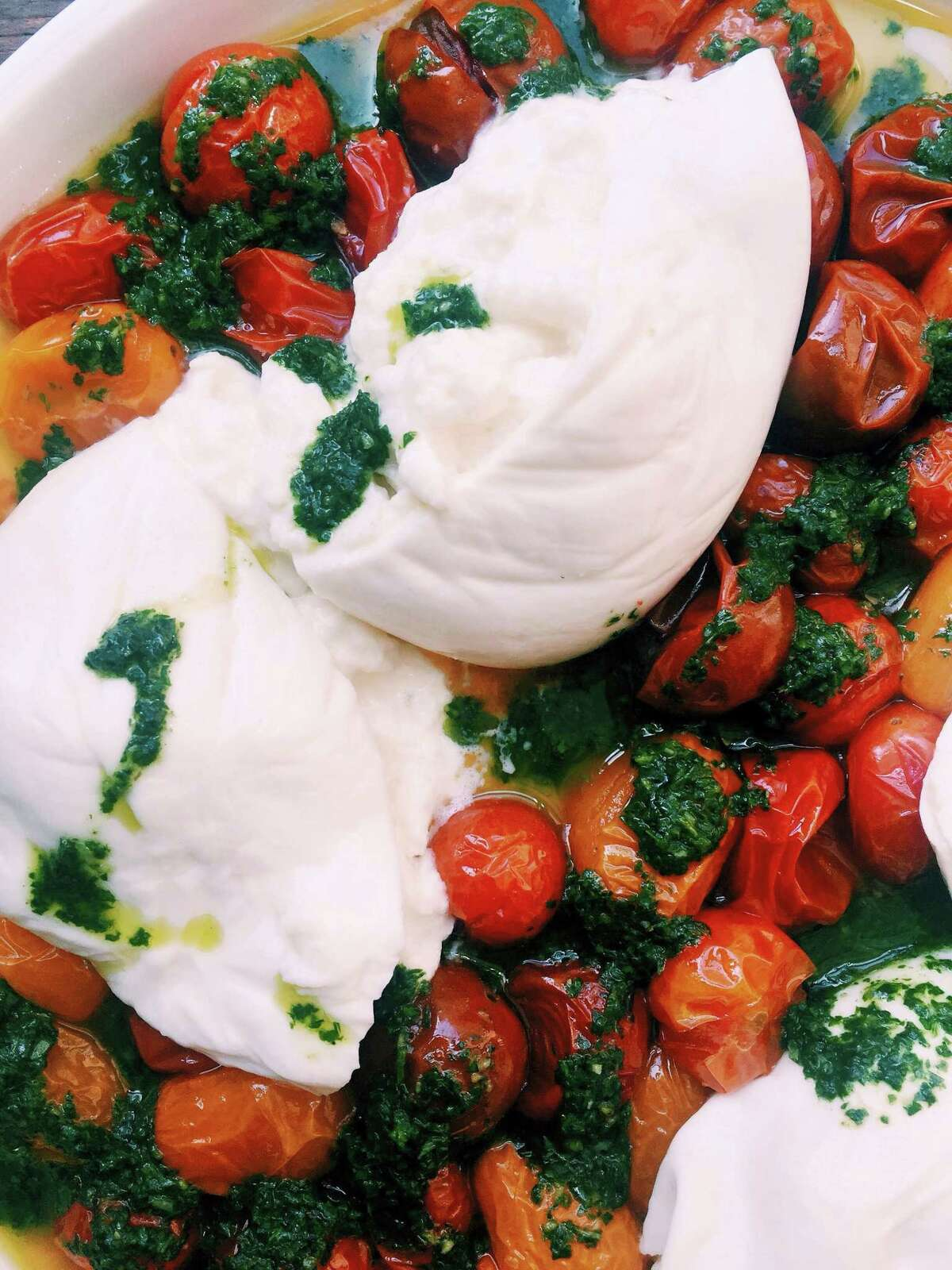 If you have never tried burrata, go out and find some and then make cherry tomatoes with burrata.
