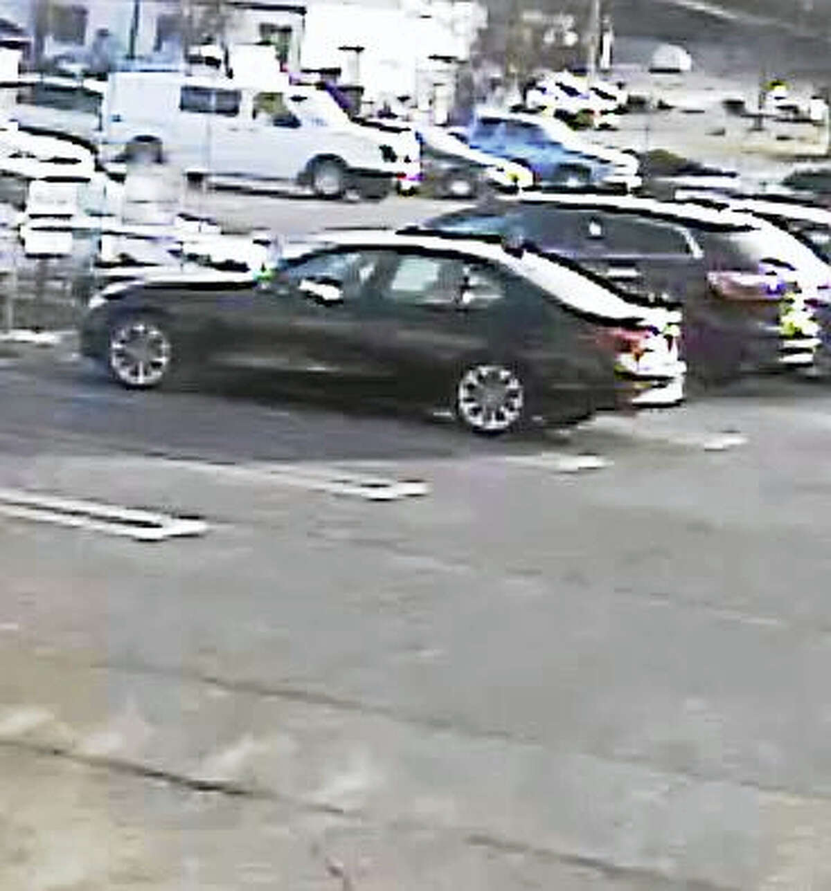 Police are looking for this black car driven by two men allegedly connected to a cloned credit card.