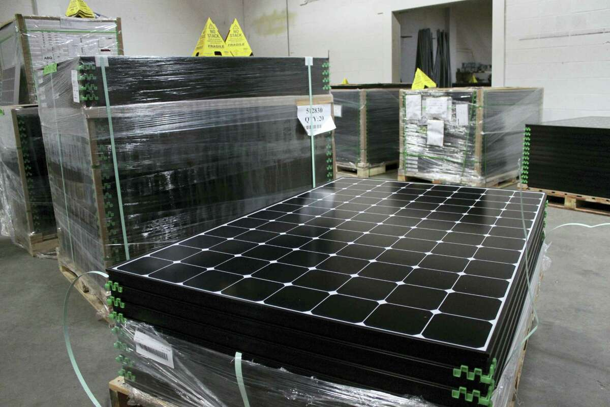 In this March 9, 2016 photo, the latest generation of SunPower solar panels are stacked in Positive Energy Solar's warehouse in Albuquerque, N.M.