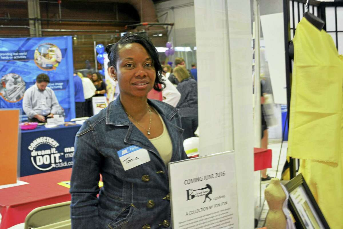 The high school career fair expo was held Friday at the Wesleyan University Spurrier Ice Rink. Shown is Tonia Herring of Tonia's Tailoring in Middletown.