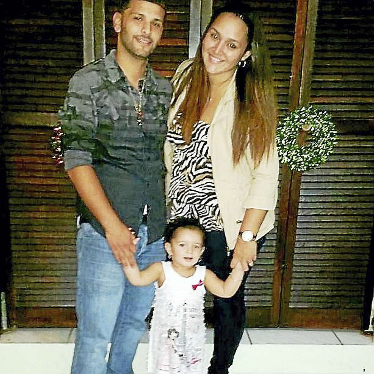 Middletown residents Jay and Katherine Figueroa pose with their 2-year-old daughter, Mariah.