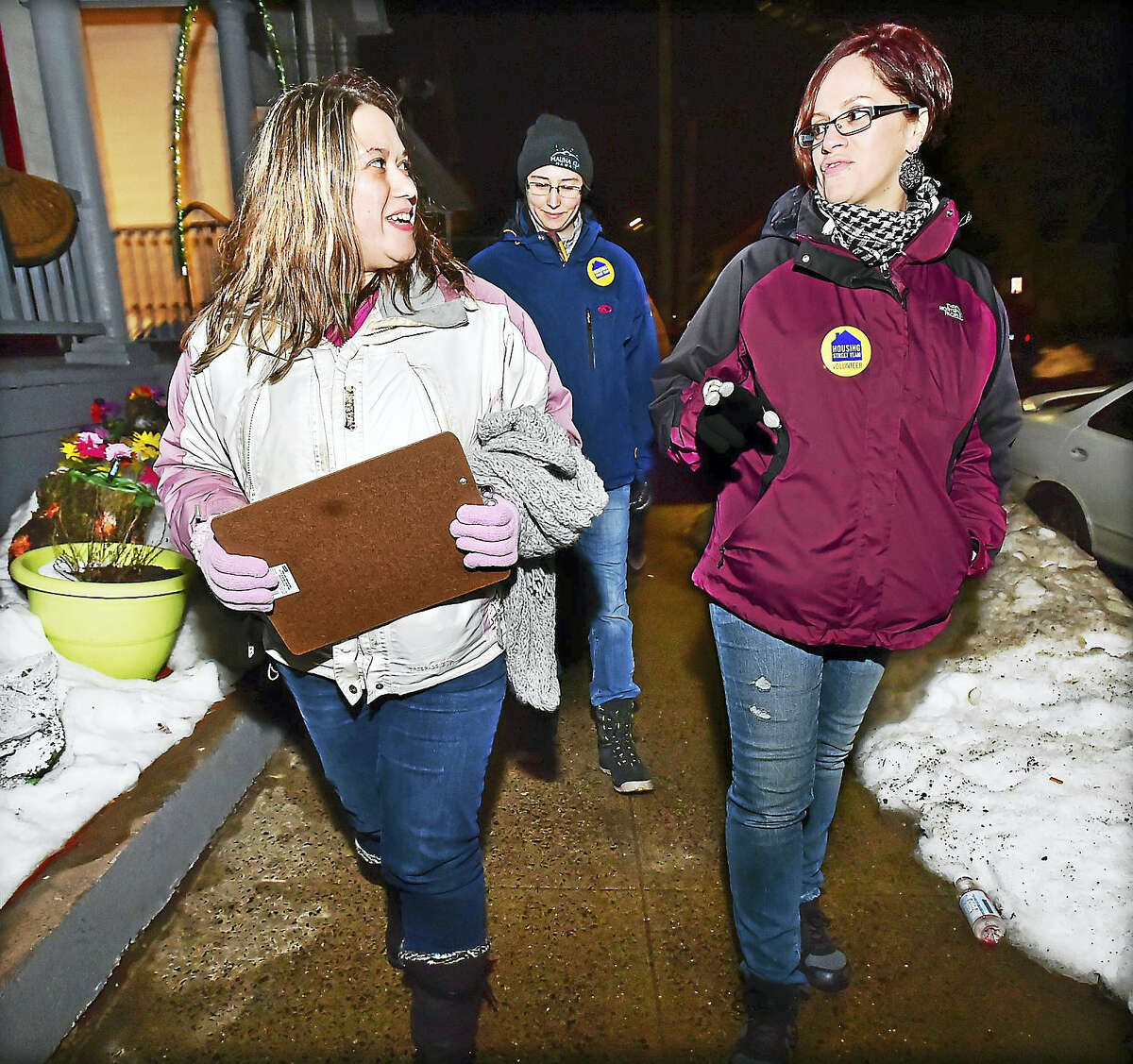 Team leader Veronica Cruz talks to Derby resident Jennifer Olivieri, who grew up in the Fair Haven section of New Haven, as the group looks for homeless individuals during the 2016 Point in Time Homeless Count on Jan. 26.