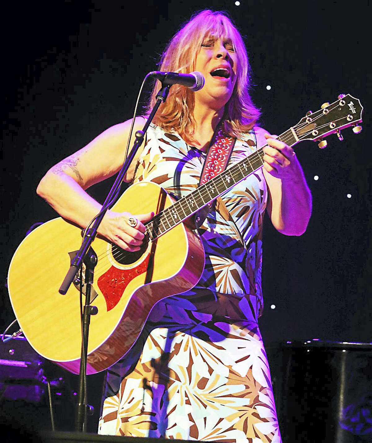 """Photo by John AtashianSinger, songwriter and guitarist Rickie Lee Jones is shown performing on stage at the Infinity Music Hall in Hartford on Aug. 28. During her five decade long career, Jones has recorded in a variety of musical styles including rock, R&B, blues, pop, soul and jazz. Additionally, she is a two time Grammy Award winner and was listed at #30 on VH1's """"100 Greatest Women in Rock & Roll"""" in 1999."""