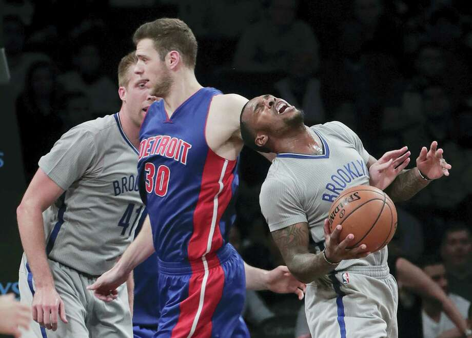 Brooklyn Nets guard Sean Kilpatrick, right, gets tangled up with Detroit Pistons forward Jon Leuer (30) during the third quarter of an NBA basketball game, Wednesday in New York. The Nets won 109-101. Photo: JULIE JACOBSON — THE ASSOCIATED PRESS  / Copyright 2016 The Associated Press. All rights reserved.