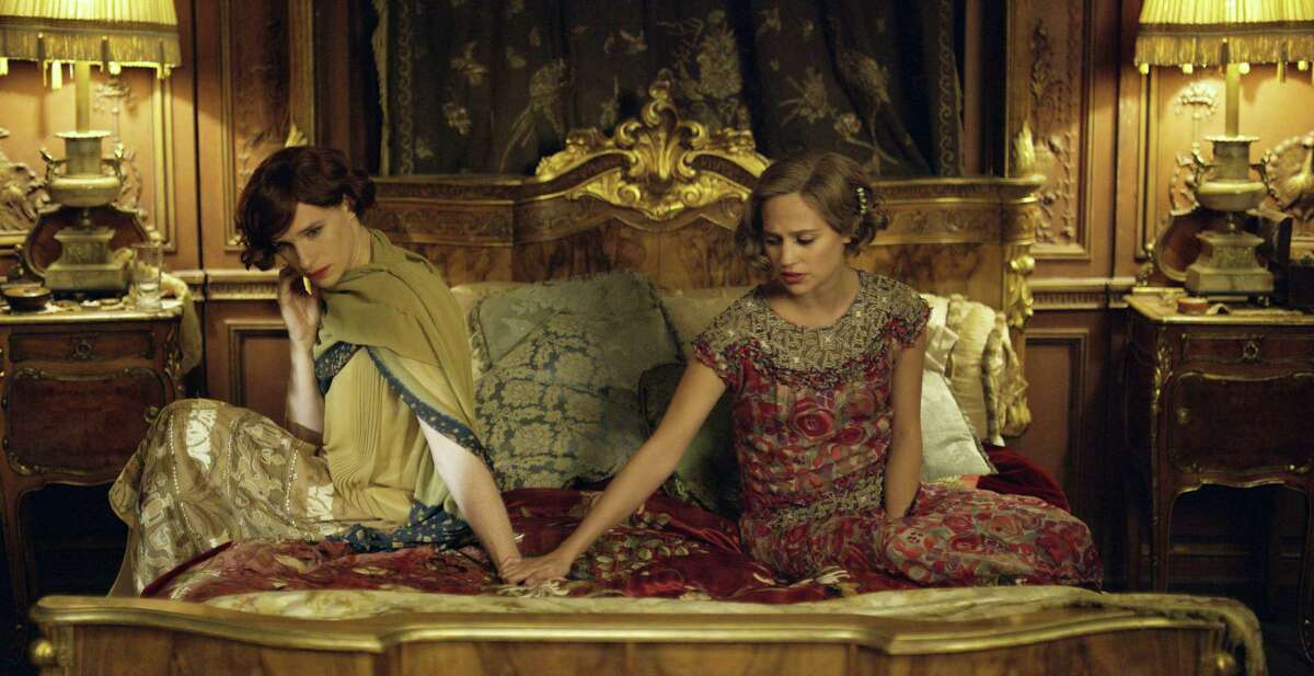 """This file photo provided by Focus Features shows, Eddie Redmayne, left, as Lili Elbe, and Alicia Vikander as Gerda Wegener, in Tom Hooper's """"The Danish Girl."""" Hollywood films remained static in their inclusiveness of LGBT characters in 2015, but the racial diversity of those characters fell dramatically, according to the findings of GLAAD's annual study released on May 2, 2016."""