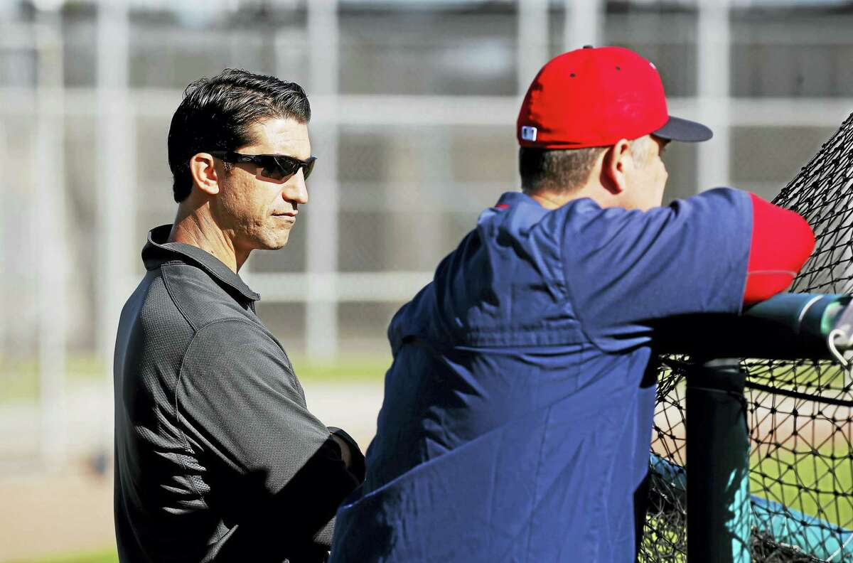 Red Sox general manager Mike Hazen, left, and manager John Farrell look on during spring training.
