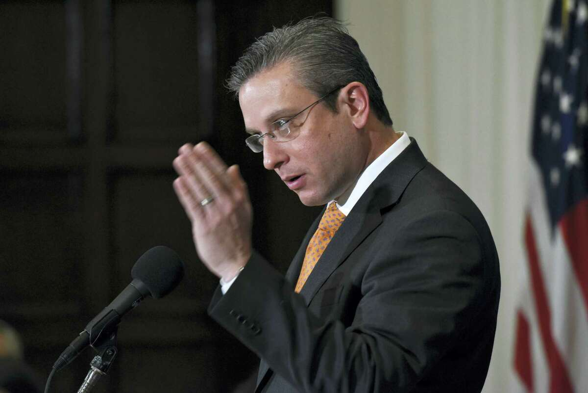 In this Dec. 16, 2015 photo, Puerto Rico Gov. Alejandro Javier Garcia Padilla speaks at a luncheon at the National Press Club in Washington. Garcia said on May 1, 2016 that negotiators for the U.S. territory's government have failed to reach a last-minute deal to avoid a third default and that he has issued an executive order to withhold payment.