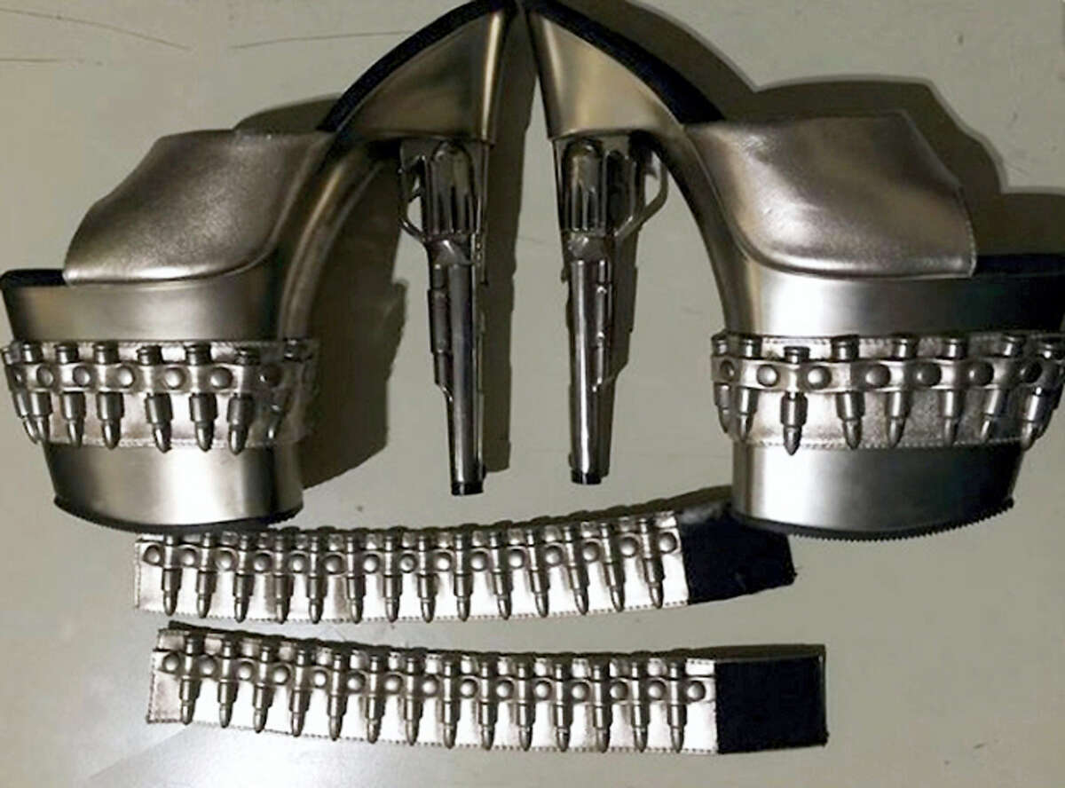 """This Sunday, Feb. 28, 2016 photo released by the Transportation Security Administration shows a pair of gun-shaped stiletto heels at Baltimore-Washington International Thurgood Marshall Airport, in Maryland. A woman had the shoes in her carry-on luggage as she tried to move through security. The agency prohibits passengers from carrying """"replica guns or ammunition"""" through airport security checkpoints. (Transportation Security Administration via AP)"""