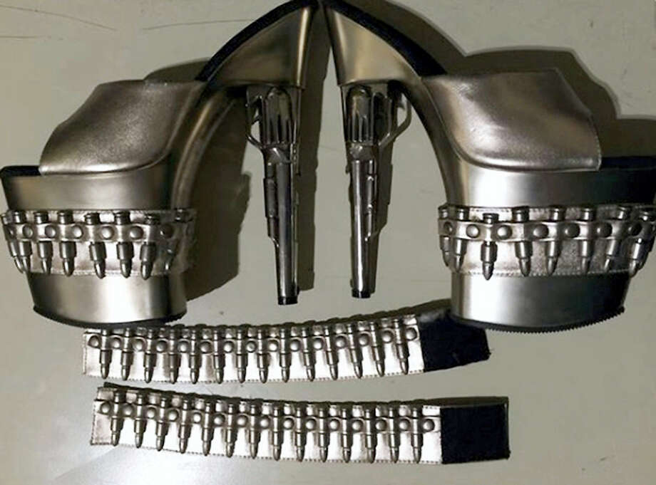 """This Sunday, Feb. 28, 2016 photo released by the Transportation Security Administration shows a pair of gun-shaped stiletto heels at Baltimore-Washington International Thurgood Marshall Airport, in Maryland. A woman had the shoes in her carry-on luggage as she tried to move through security. The agency prohibits passengers from carrying """"replica guns or ammunition"""" through airport security checkpoints. (Transportation Security Administration via AP) Photo: AP / Transportation Security Administration"""