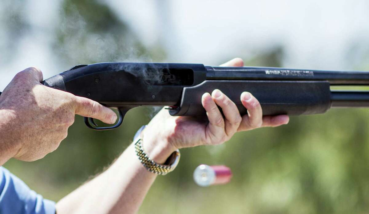 """In this photo taken April 7, 2016, Jonathan Mossberg, whose iGun Technology Corp. is working to develop a """"smart gun,"""" demonstrates the firearm, in Daytona Beach, Fla. Mossberg is among a group of pioneers looking to build a safer gun. But unlike many others, he was in the gun business when he started down that path. Mossberg has been working to develop and someday bring to market a firearm that can't be fired by the wrong person, but works without fail in the hands of its owner in a life-or-death situation."""
