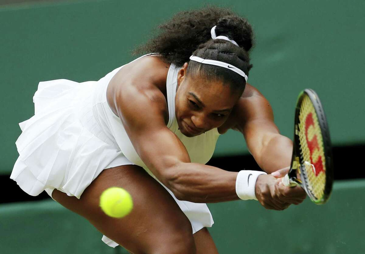 Serena Williams rallied past fellow American Christina McHale to reach the third round at Wimbledon Friday.