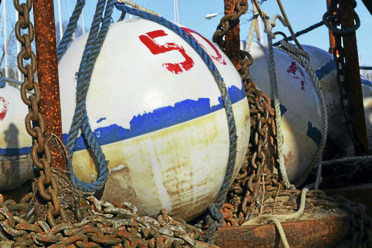 Shown is a view of mooring buoys at the Yankee Boatyard and Marina Monday along the Connecticut River.