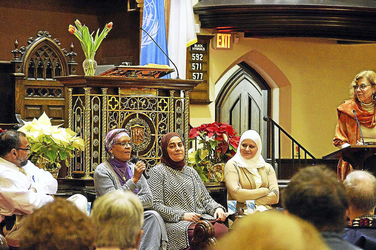 """The Middletown Refugee Resettlement Coalition hosted an event called """"Honest Conversations with your Muslim Neighbors"""" last month at First Church of Christ. From left, panel members Reza Mansoor, Linda Miller, Feryal Salem and Maryam Bitar interact with the audience."""