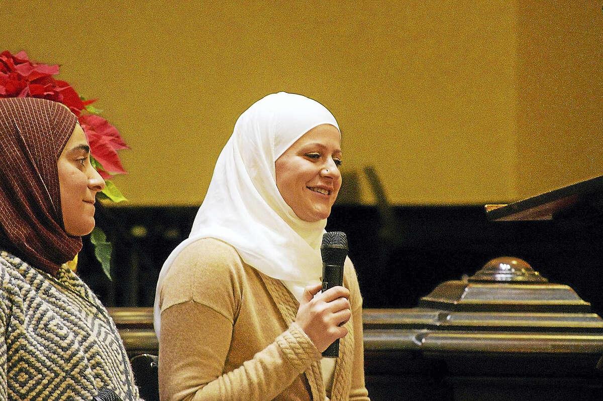 Courtesy photo Maryam Bitar speaks to those gathered while Feryal Salem looks on.