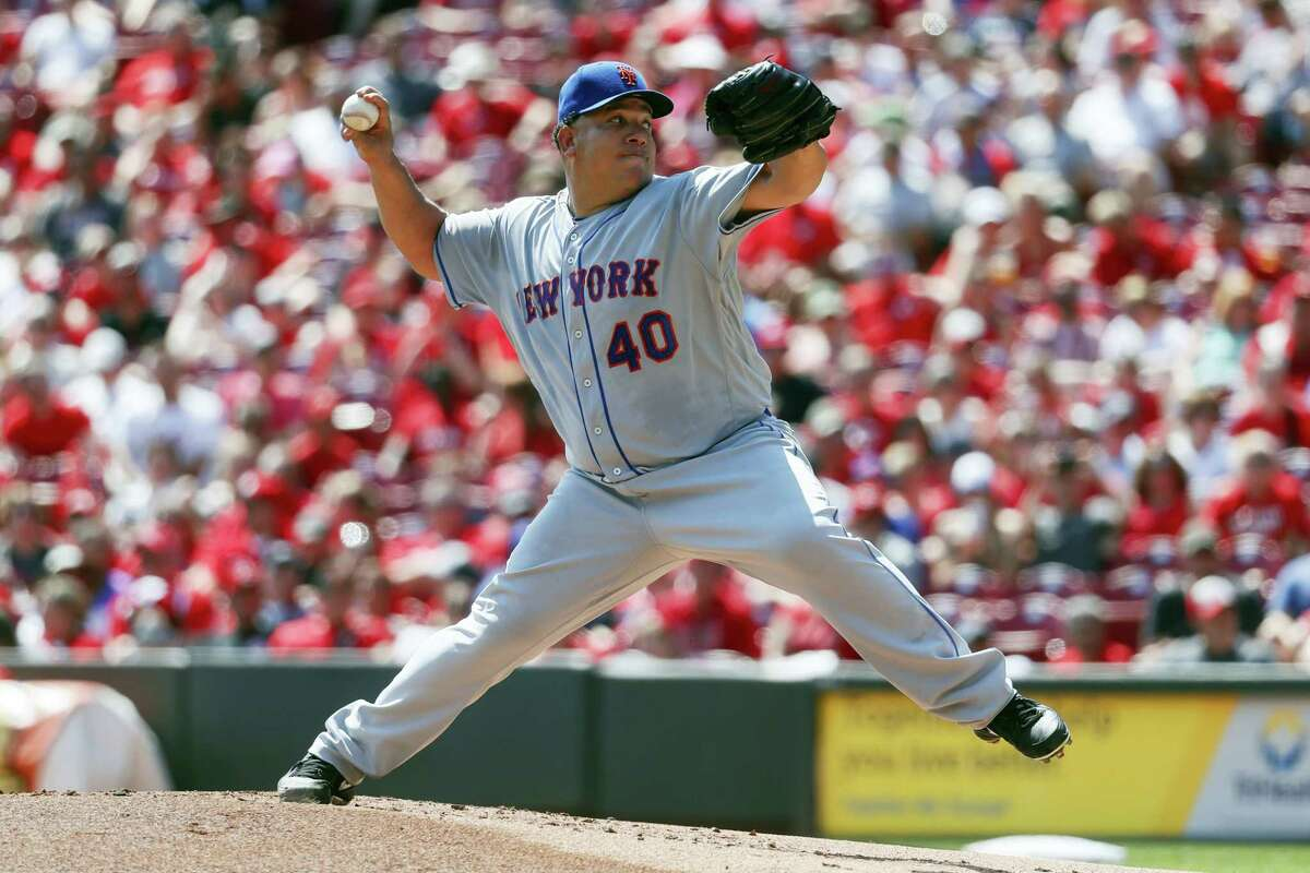 New York Mets starting pitcher Bartolo Colon throws during the first inning against the Cincinnati Reds Monday in Cincinnati. The Mets won 5-0.