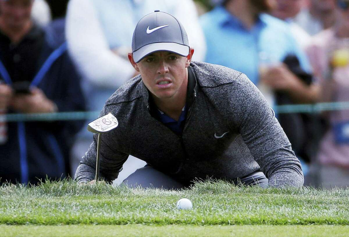 Rory McIlroy lines up a putt on the 15th hole during the final round of the Deutsche Bank Championship golf tournament in Norton, Mass., Monday. McIlroy won the tournament by two shots.