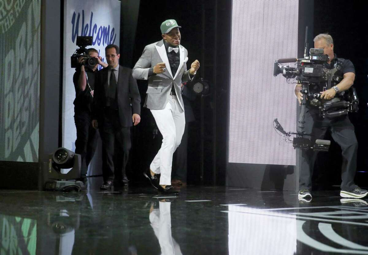 Ohio State's Darron Lee dances as he walks on the stage after being selected by the New York Jets as the 20th pick in the first round of the NFL draft on Thursday.