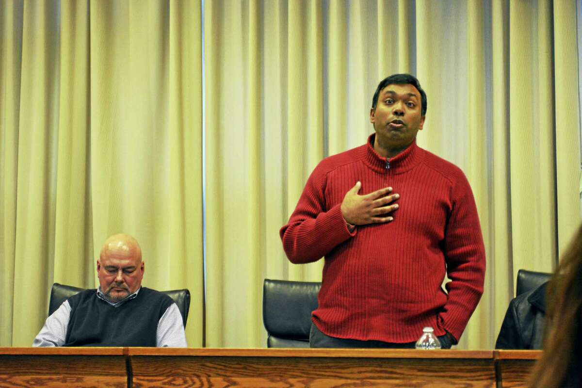 Geen Thazhampallath, director of parking and president of the United Public Service Employees Union Local 6457, asks Segal Waters senior consultant Patrick Bracken (not pictured) a question following his presentation Monday afternoon in council chambers.