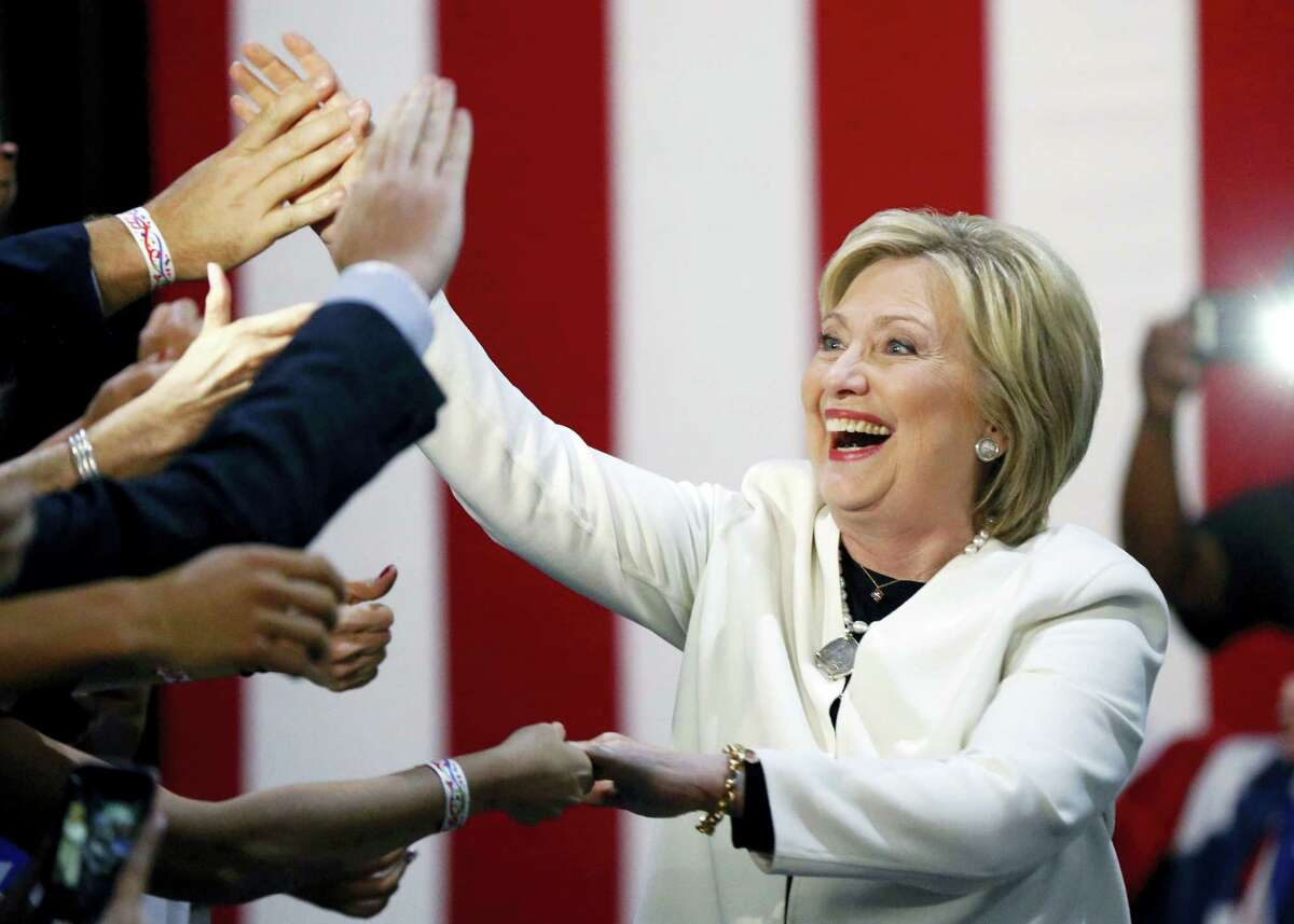 Democratic presidential candidate Hillary Clinton reacts to supporters as she arrives to address supporters at her Super Tuesday election night rally in Miami, Tuesday, March 1, 2016.