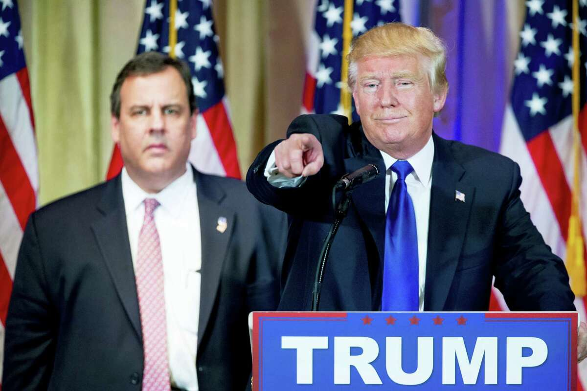 Republican presidential candidate Donald Trump, accompanied by New Jersey Gov. Chris Christie, left, takes questions from members of the media during a news conference on Super Tuesday primary election night in the White and Gold Ballroom at The Mar-A-Lago Club in Palm Beach, Fla., Tuesday, March 1, 2016.