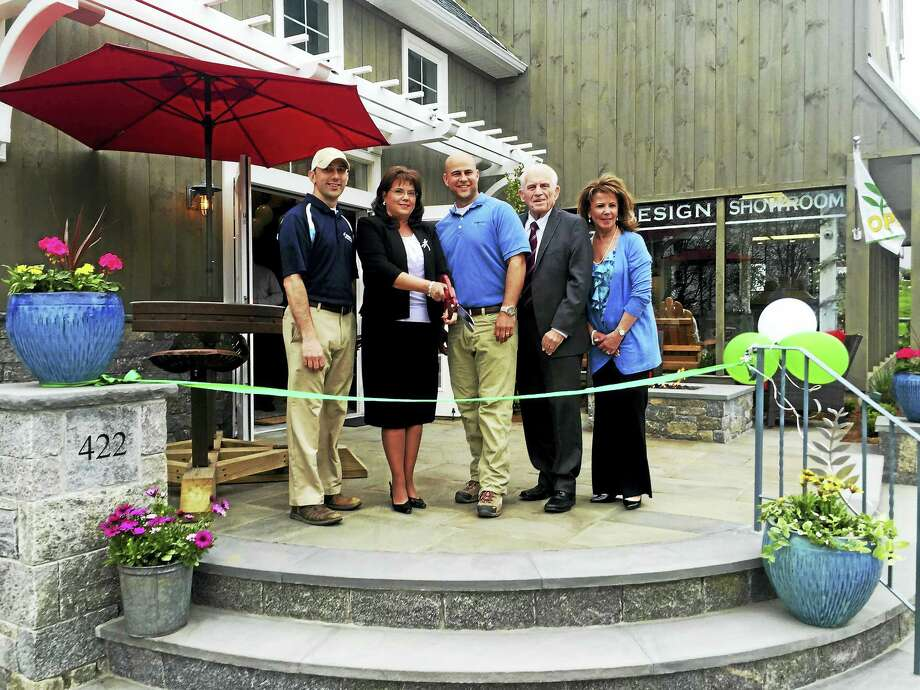 Torrison Stone & Garden held a ribbon-cutting and good neighbor open house on April 28 at its renovated located in Durham. From left are landscape architect at Torrison Stone & Garden Brian Murphy, Durham First Selectman Laura Francis, Torrison owner Tyler Gerry, president of the Middlesex County Chamber of Commerce Larry McHugh and Torrison business manager Suzanne Ciofalo. Photo: Courtesy Photo