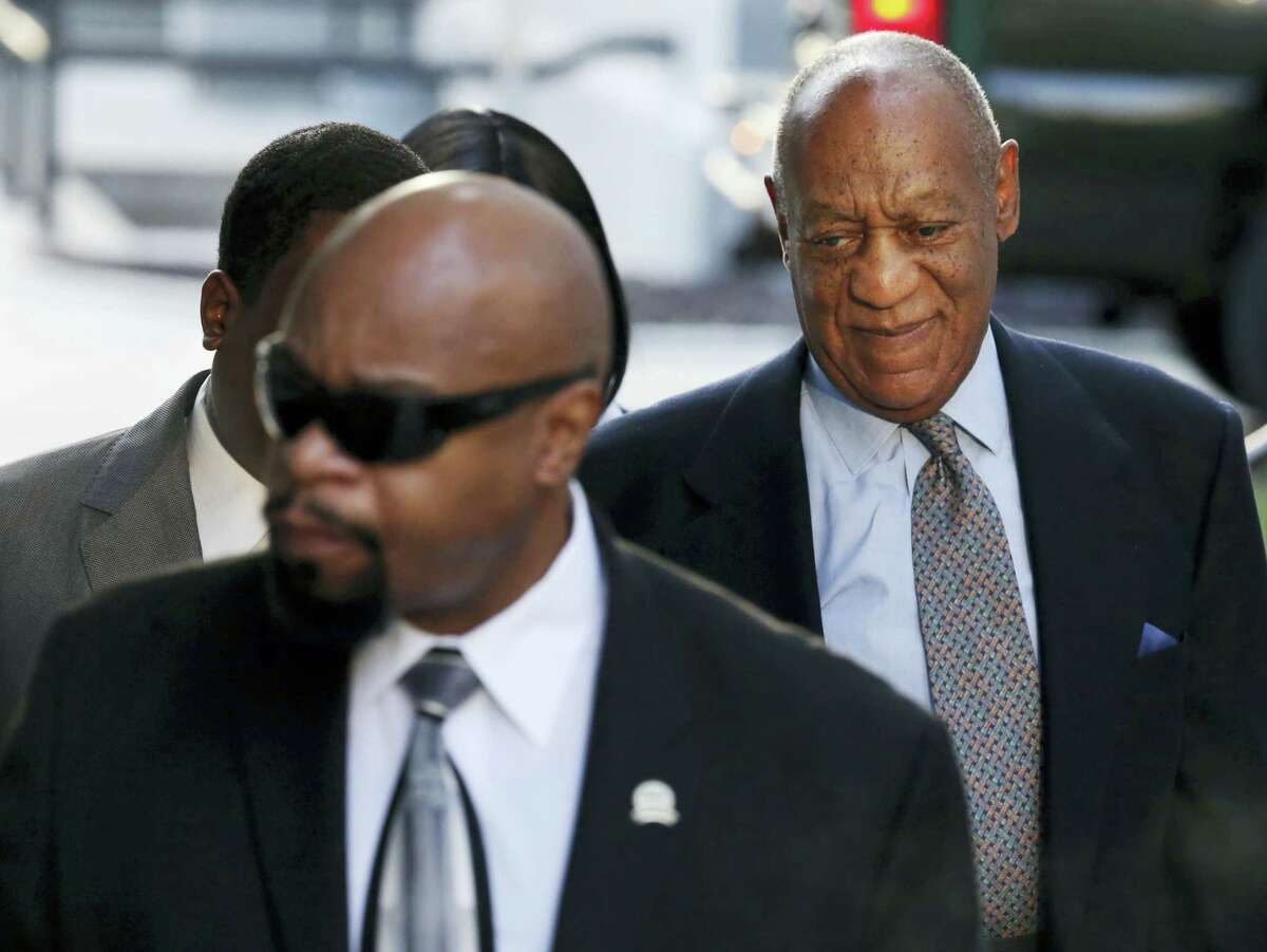 """Bill Cosby, right, arrives for a hearing in his sexual assault case at the Montgomery County Courthouse on Nov. 1, 2016 in Norristown, Pa. Prosecutors at the pretrial hearing on Tuesday will ask the judge to let the other accusers testify to show Cosby drugged and molested young women in a """"signature"""" fashion."""