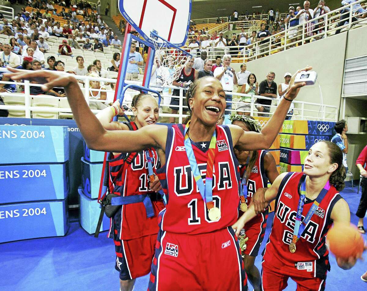 From left, Diana Taurasi, Tamika Catchings and Sue Bird celebrate during the 2004 Olympics in Athens, Greece.