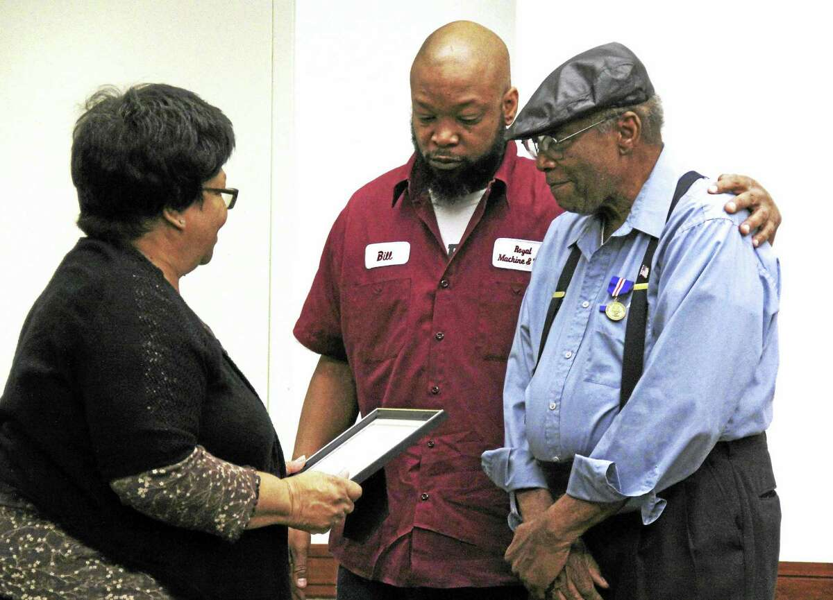 Cora Coleman and son Bill join David Coleman during a pinning ceremony to honor the U.S. Navy veteran through combined efforts of St. Luke's Community Services, UConn School of Nursing and Middlesex Hospital.