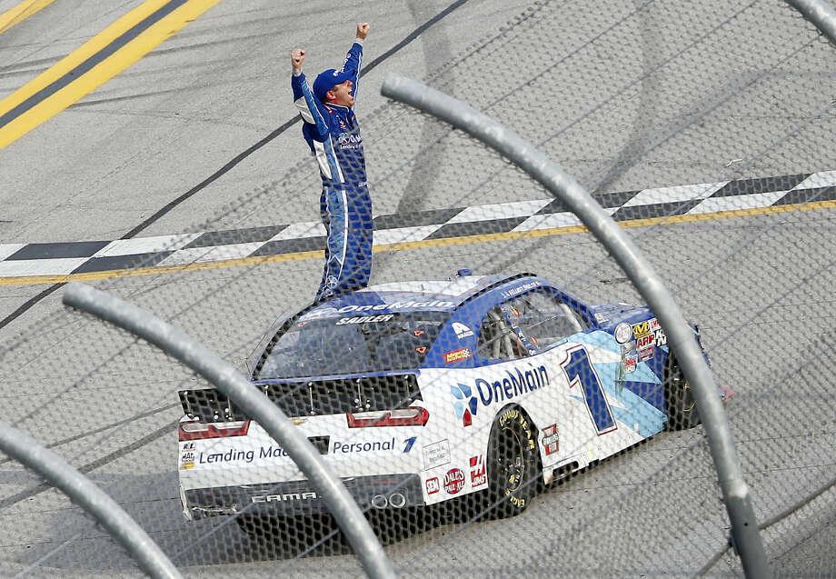 Elliott Sadler celebrates after winning the Xfinity Series race at Talladega Superspeedway Saturday in Alabama. Photo: John Bazemore — The Associated Press  / AP
